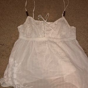 flowy white tank with beaded detailing and bow